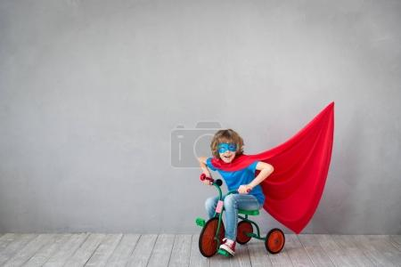 Child pretend to be superhero