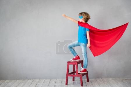 Child pretend to be superhero