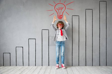 Photo for Child pretend to be businessman. Kid playing at home. Imagination, idea and start up concept. Back to school - Royalty Free Image