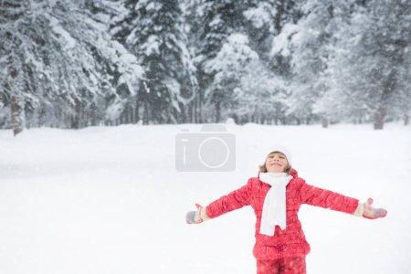 girl in snowy winter park