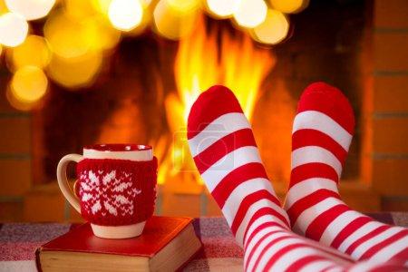 feet in warm christmas socks