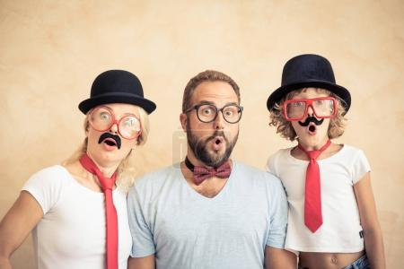 Photo for Funny man, woman and kid with fake mustache. Happy family playing in home - Royalty Free Image