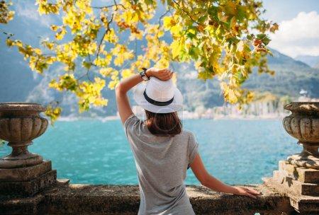 Woman relaxing on Garda lake