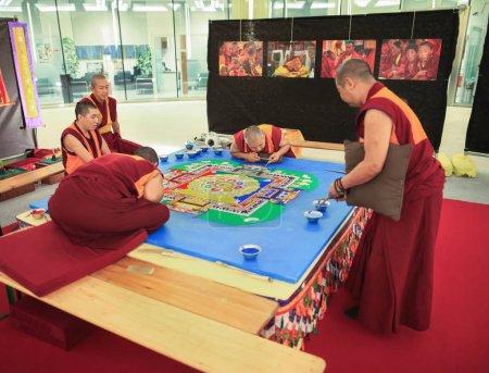 Buddhist creating mandala