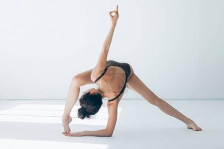 Young beautiful dancer posing