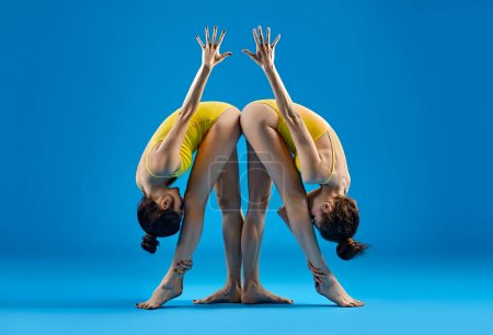 Two young women doing yoga asana