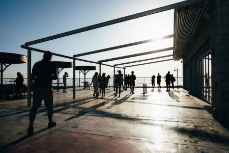 people walking on terrace