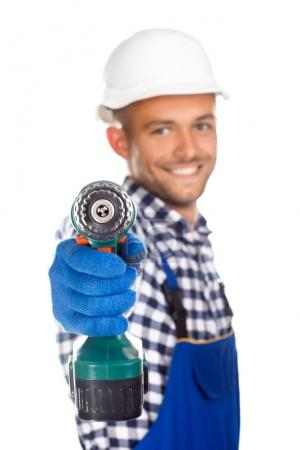 Smiling construction worker with drill