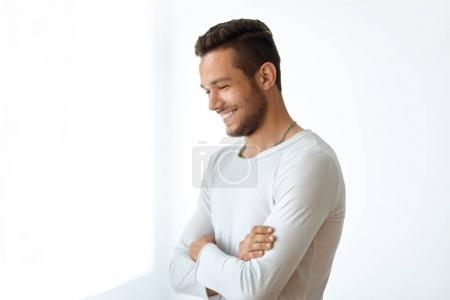 smiling handsome man with crossed arms