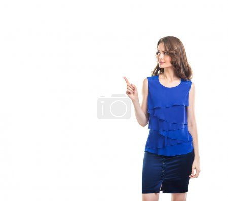 Young beautiful woman pointing copy space