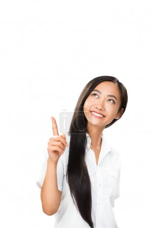 Carefree smiling Asian woman pointing finger up