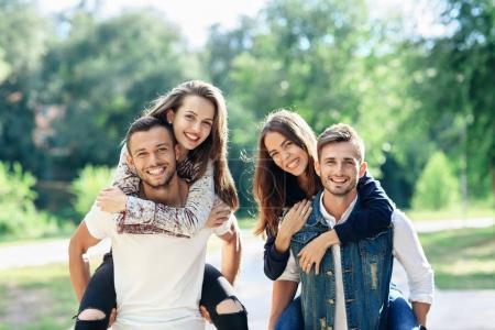 loving couples having piggyback ride