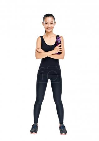 Smiling young Asian athlete standing confidently and holding sipper bottle isolated on white background