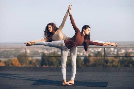 women doing yoga asana