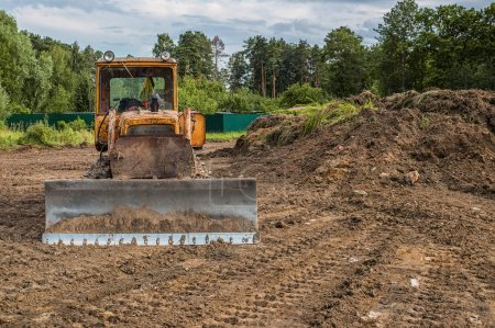 The excavator cleared the land leaving traces . Selective focus. Copy space.