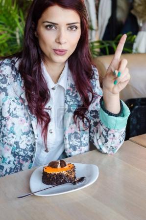 Beautiful girl  eating cake.