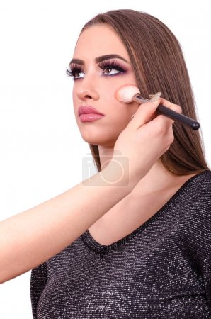 woman doing makeup and facial contouring