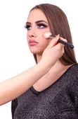 woman doing makeup and facial contouring
