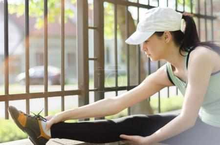 Girl  massaged injured ankle