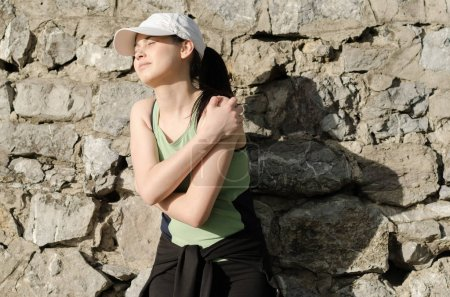 girl holding a dislocated shoulder