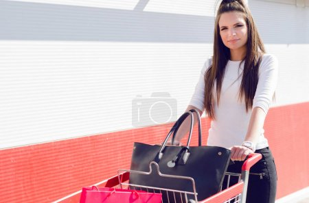 woman pushing a shopping trolley