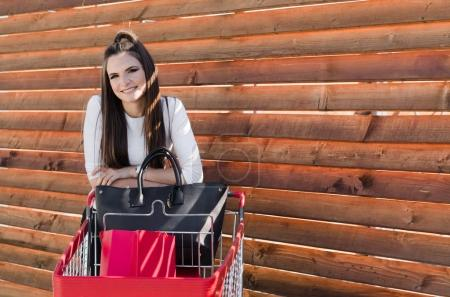 woman posing with shopping trolley