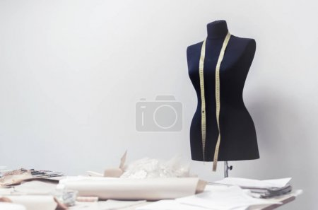 Photo for Black dummy with measuring tape in tailors studio, copy space - Royalty Free Image