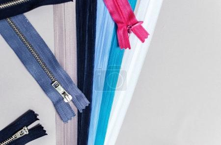 colorful zipper with a top view and space for text
