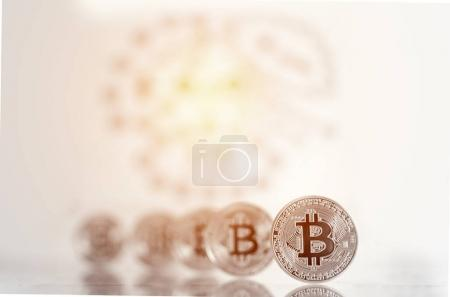 Bitcoins replica on black chalkboard background