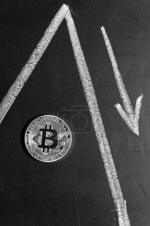 Bitcoin replica on black chalkboard background
