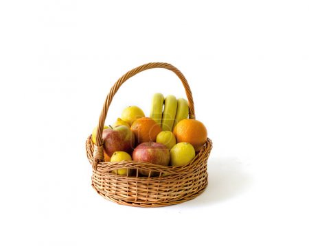 Real and normal look of basket with fruits isolated on white background with shadow