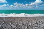 Beach, blue sea, cloudy sky. Beautiful landscape