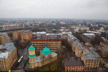 RIGA, LATVIA - 25 DEC 2015. Annunciation of Our Most Holy Lady or St. Nicholas the Miracle Worker Church is one of the oldest churches in Riga. Aerial view, grey cloudy day.