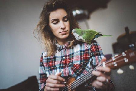 girl playing ukulele guitar