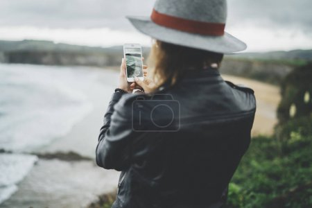 traveler girl taking a photo