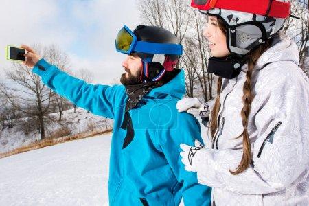 Snowboarders taking selfie