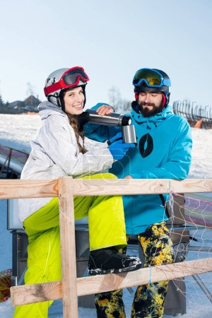 Snowboarders drinking tea