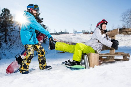 Photo for Happy young couple of snowboarders fooling aroung at ski resort - Royalty Free Image