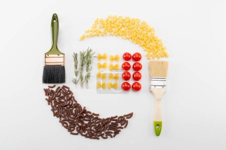 Photo pour Colorful different types macaroni italian pasta, tomatoes and two brushes isolated on white - image libre de droit