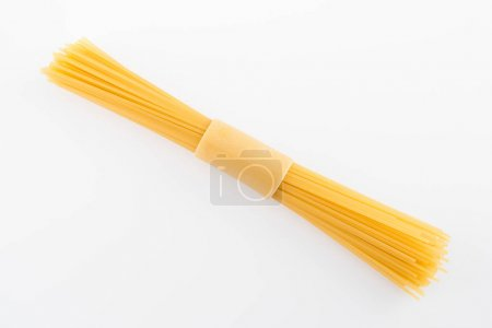 Photo for Top view of raw vermicelli italian pasta isolated on white - Royalty Free Image