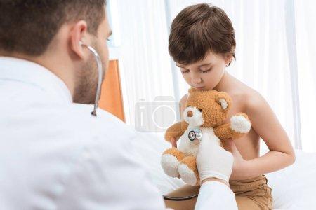 Doctor examining child patient