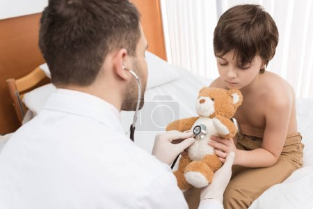 Doctor examining child patient