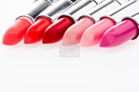 Photo for Close-up view of fashionable lipsticks set isolated on white - Royalty Free Image