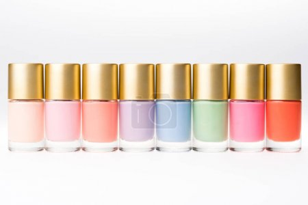 Photo pour Close up view of various colorful nail polishes isolated on white - image libre de droit