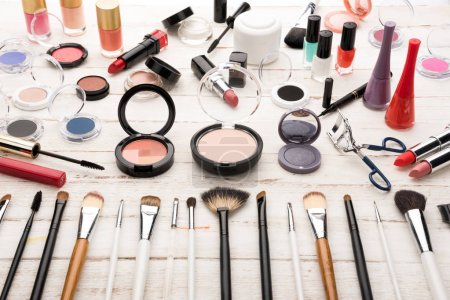 Photo for Close up view of various brushes and cosmetics for applying makeup on table - Royalty Free Image