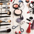 Close up view of various brushes and cosmetics for...