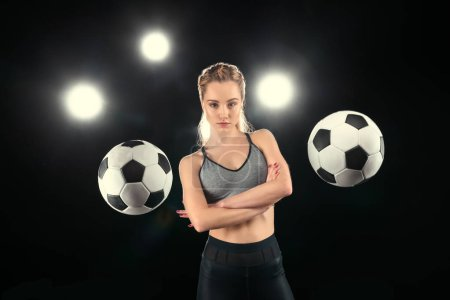 Woman with soccer balls