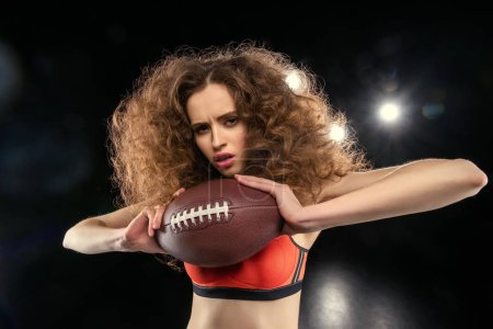 Woman holding rugby ball