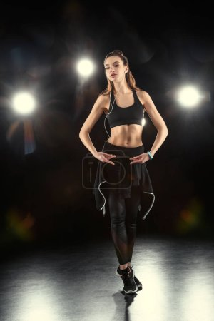 Dancing sporty woman