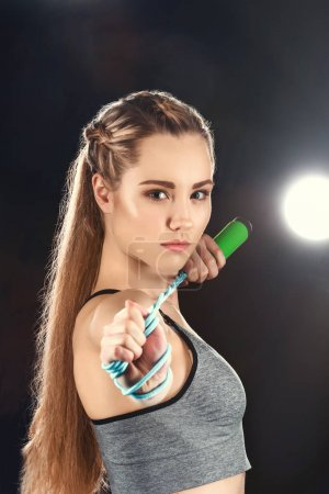 woman holding skipping rope